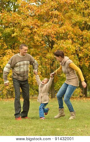 Activity happy family relaxing in forest
