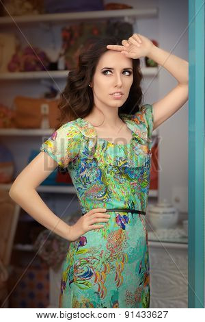 Woman in Green Floral Dress in Fashion Store