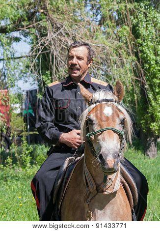 Makeevka, Ukraine - May, 7, 2014: Cossack In Uniform On Horseback