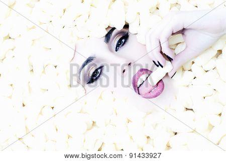 Fashionable Young Beautiful Girl Face In Corn Sticks Heap