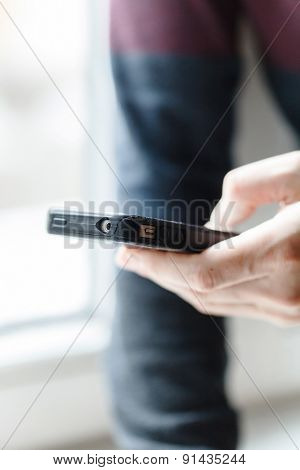 man hands touching smartphone