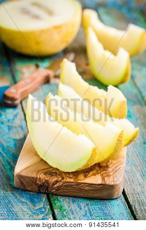Slices Of Fresh Melon On Cutting Board