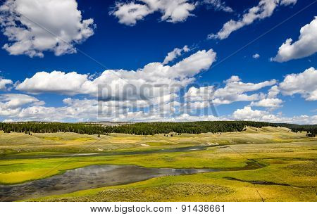 Landscape View Of Meadows And River In Yellowstone, Usa