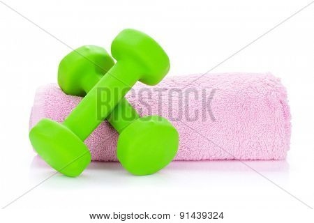 Two green dumbells and towel. Isolated on white background
