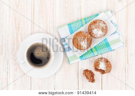 Homemade cakes and coffee cup on white wooden table. Top view