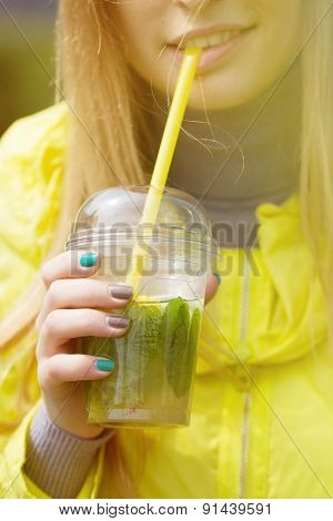 Girl Is Drinking A Large Glass Of Lemonade