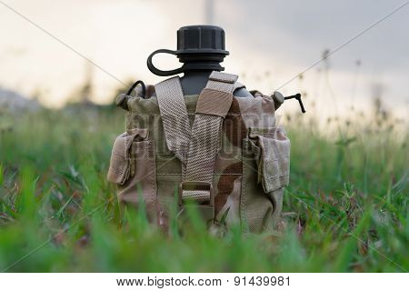 Army water canteen with desert cover