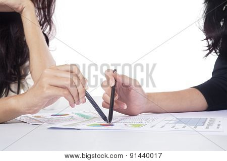 Businesspeople Hands Pointing At Business Chart