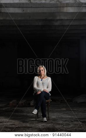 Portrait of young beautiful woman in an abandoned factory