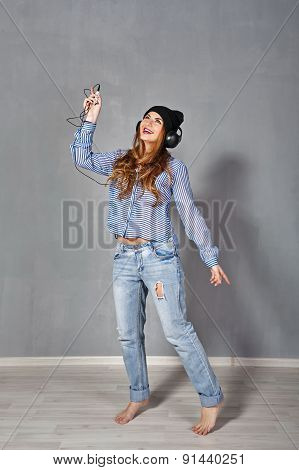 Hipster Girl Listening To Music On Headphones.