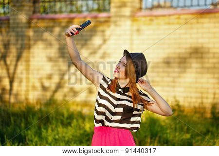 Lovely Girl In A Hat On The Street Makes Selfei
