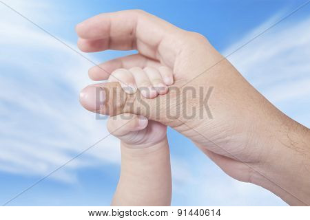 Infant Hand Holds Father Finger