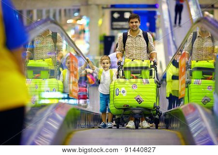 Happy Family With Baggage On Conveyor In Airport, Ready To Travel