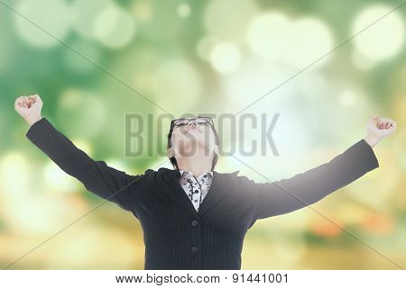 Successful Woman With Bokeh Background