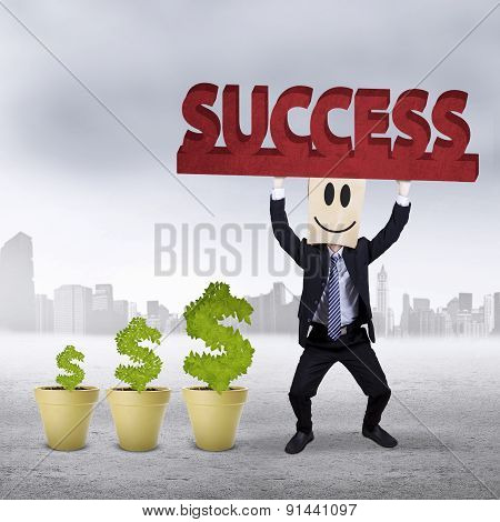 Successful Worker With Money Tree Outdoors