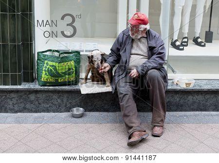 Beggar With Dog