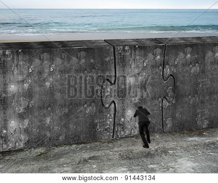 Man Pushing Huge Puzzle Door Of Concrete Wall
