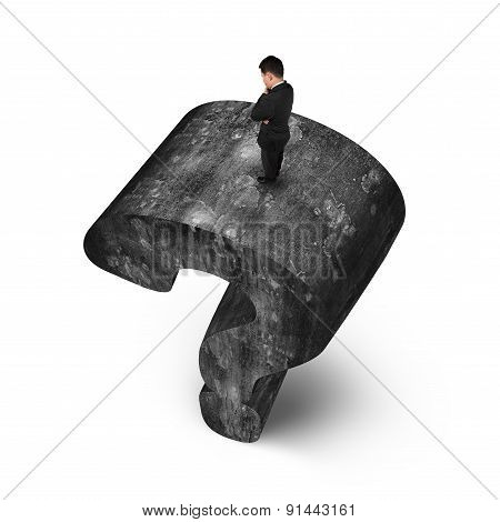 Man Standing On Huge 3D Concrete Question Mark White Background