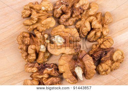 Walnut kernels as background.