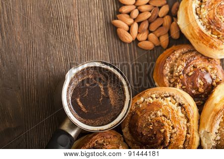 coffee and cinnamon rolls on wooden blackboard