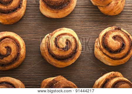 9 cinnamon rolls on wooden blackboard