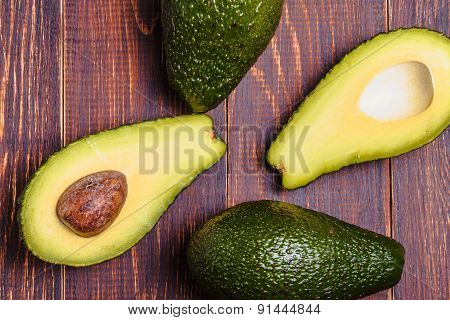 Avocado On A Brown Background