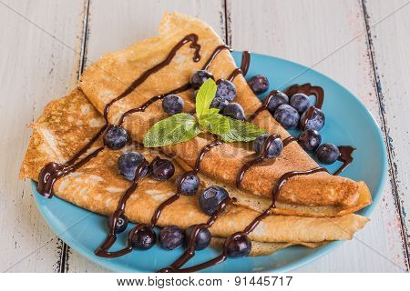 Homemade Crepes With Blueberries And Chocolate Syrup