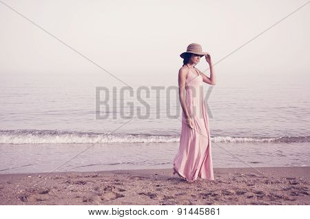Beautiful Woman With Long Pink Dress On A Tropical Beach