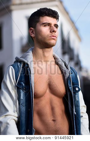 Handsome Young Man With Blue Eyes Posing In Urban Background