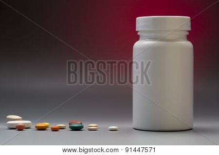 Plastic white medical bottle on a colorful background