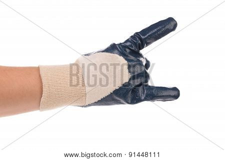 Hand in rubber glove shows rock sign.