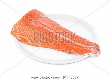 Raw salmon fillet on plate.