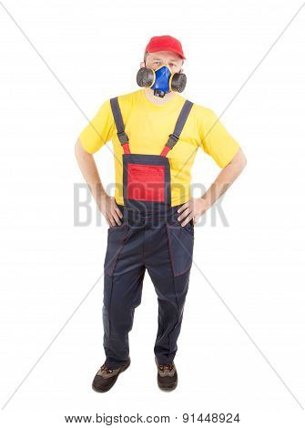 Worker in hat with respirator.