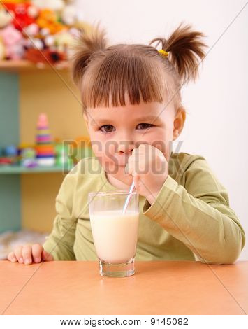 Happy Little Girl Drinks Milk