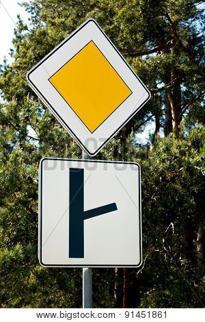 Sign Of The Main Road And A Fork