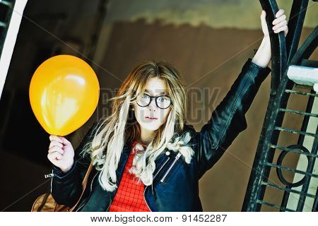 young hipster woman with balloon in the city, spring time