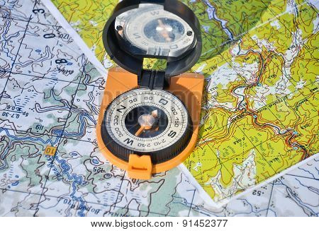 Map, Compass And Shadow