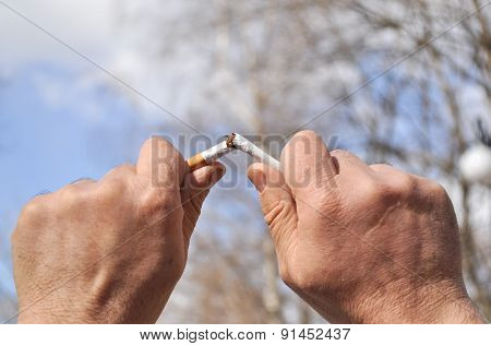 Broken Cigarette In His Hand