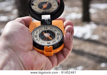 The Compass In Man's Hand Outdoors.
