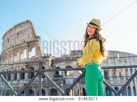 Happy Woman Tourist At Colosseum In Rome In Summer