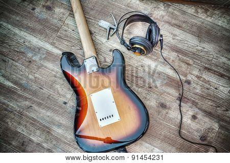 Electric Guitar And Headphones On A Wooden Board In Hdr