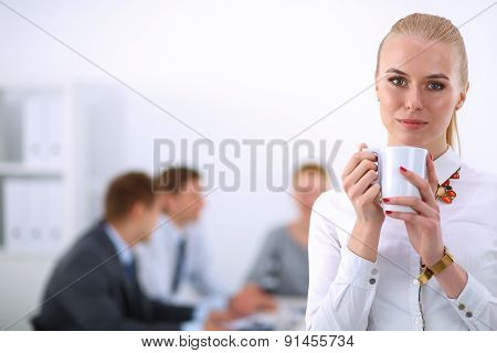 Portrait of a young woman working at office standing