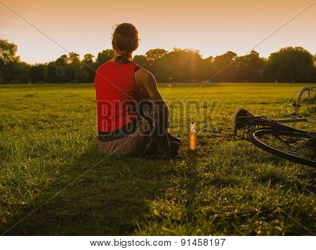Woman Admiring Sunset In Park
