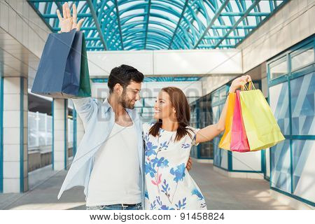Happy Young Couple At Shopping