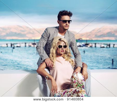 Happy fashionable couple on sunny vacation day