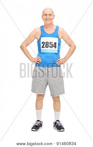Full length portrait of a senior man in sportswear smiling and looking at the camera isolated on white background