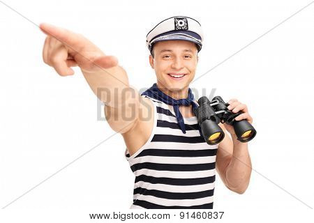 Male sailor holding binoculars and pointing with his hand isolated on white background