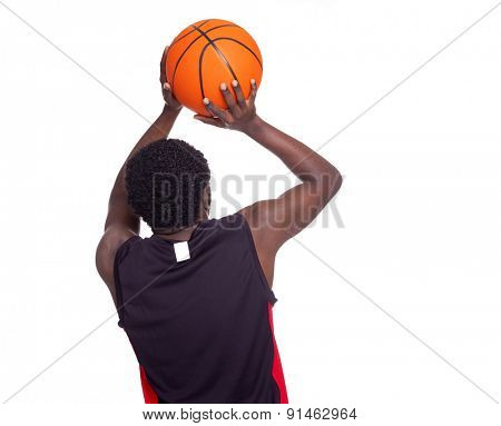 Rear view of a basketball player, isolated on white background