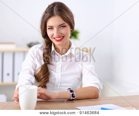 Attractive businesswoman sitting in the office.