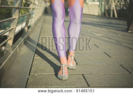 Woman In Leggings Walking On Bridge